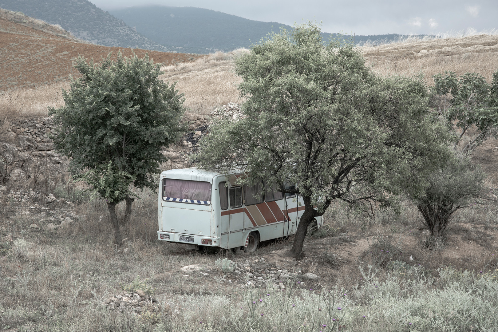A bus parked in the shade near Hieropolis Turkey