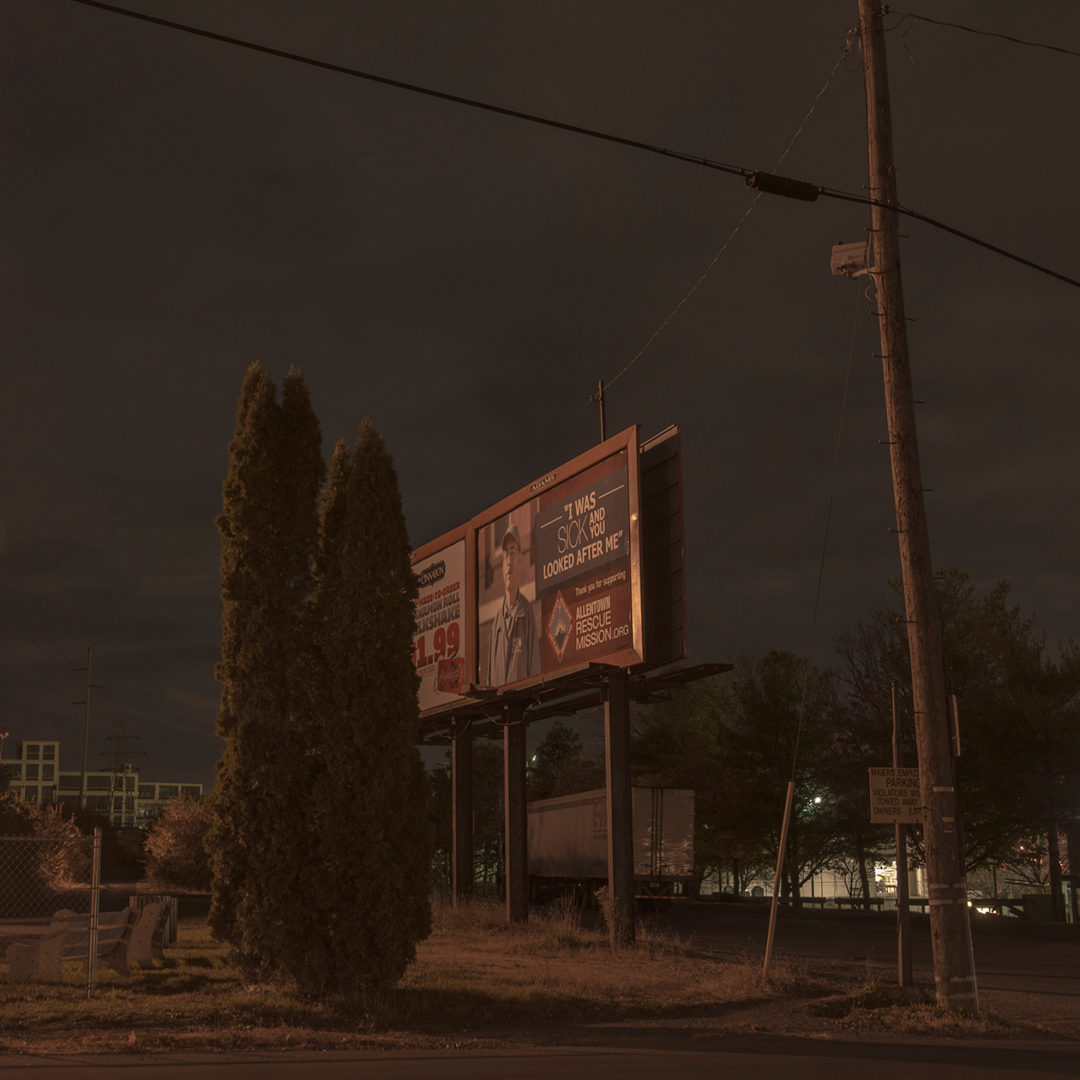 Junipers and a Billboard