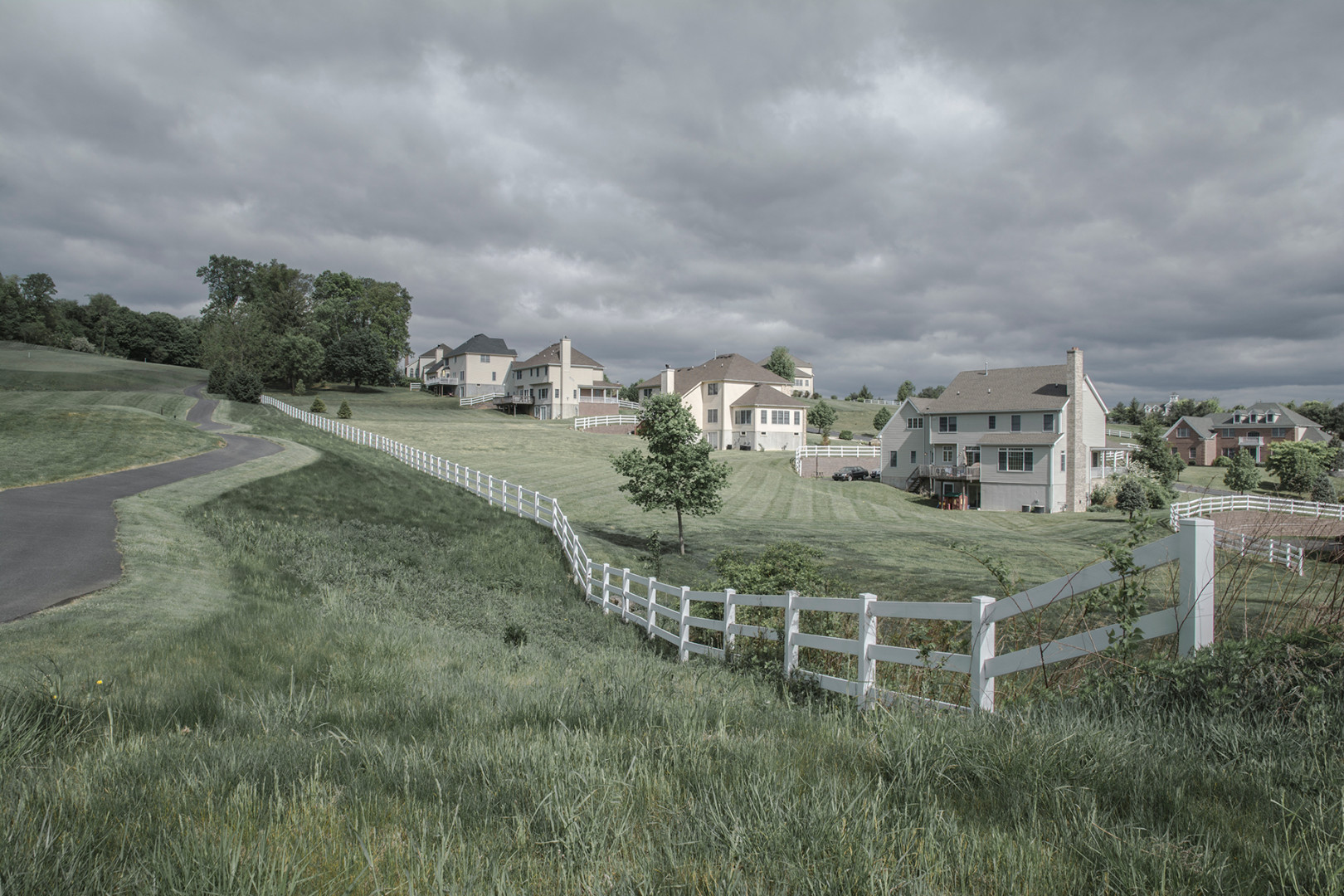 The back of a Suburban Development with a Golf Course