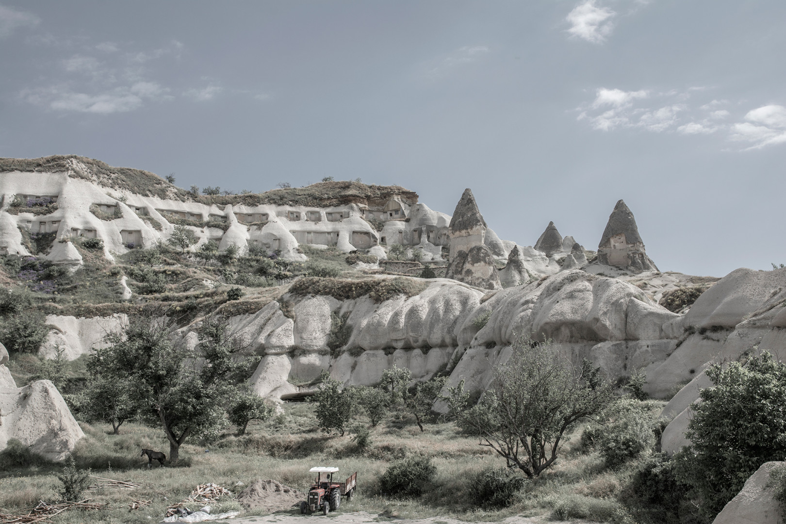 A red tractor and a horse in Goreme Turkey