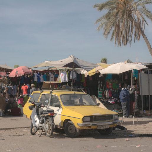 Yellow Car at the Market